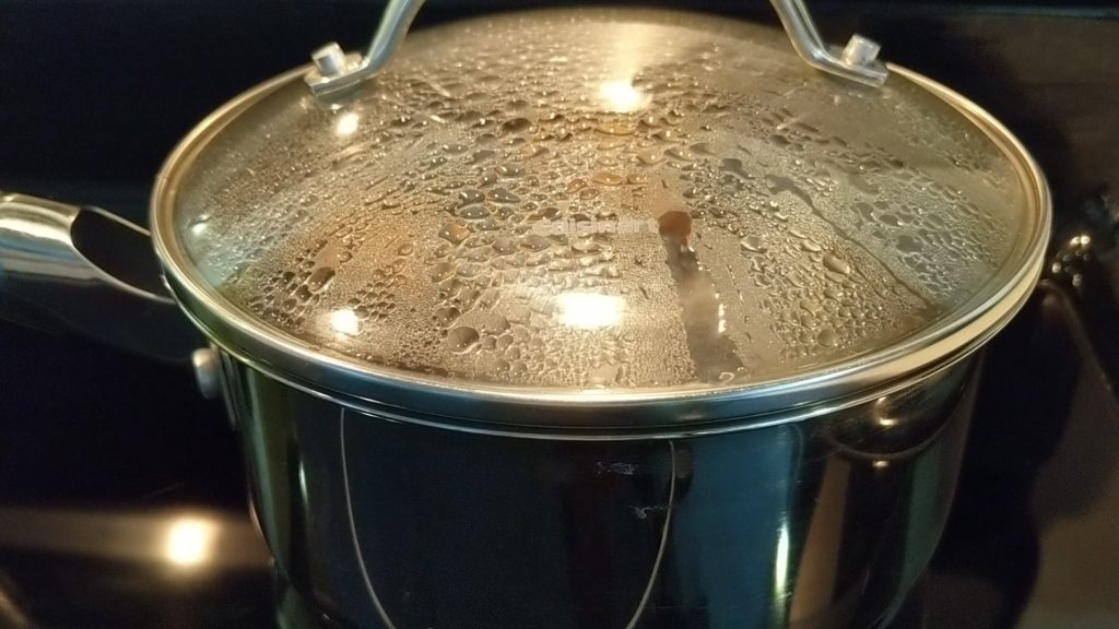 Covered boiling water with eggs off the heat