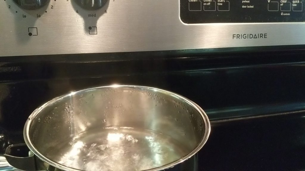 Water reaches boiling point with a rolling boil