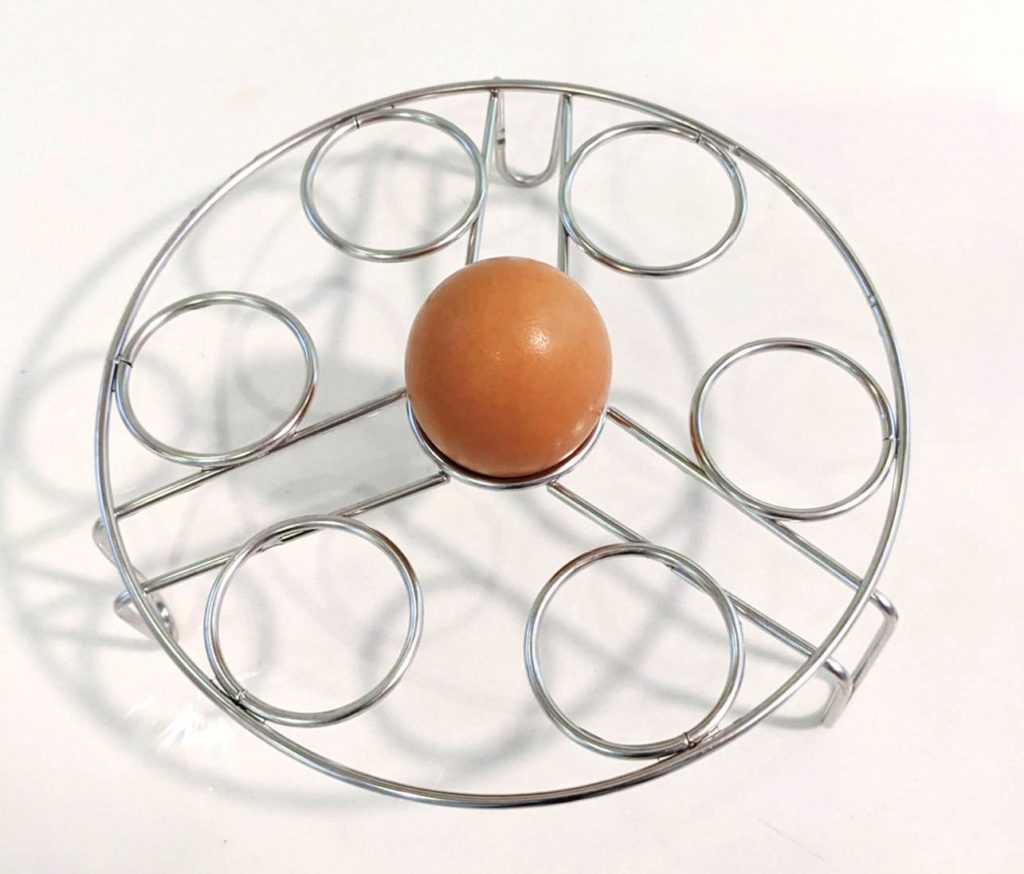 Boiled egg in wire rack