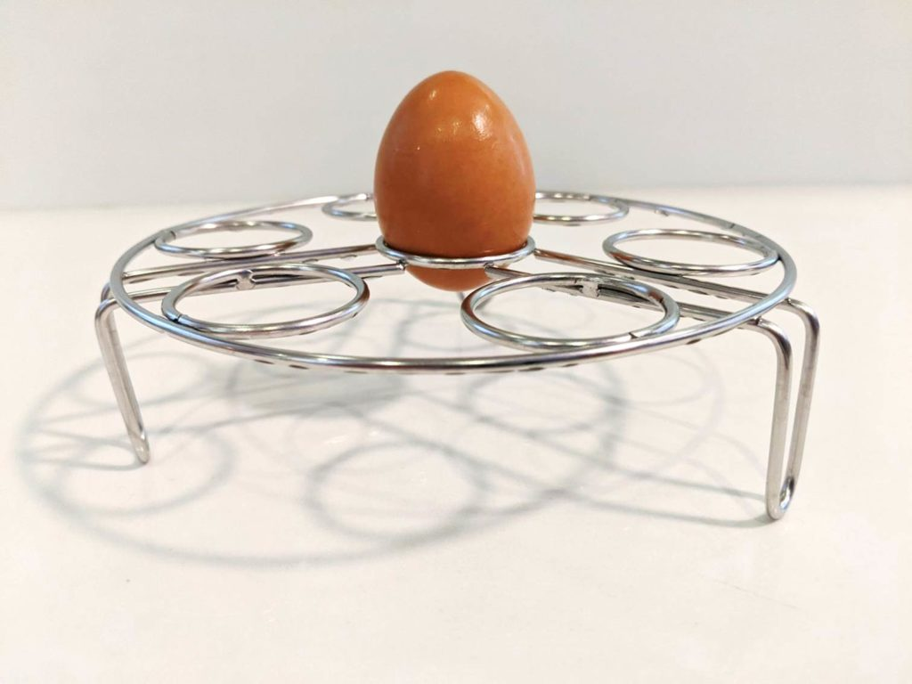 Boiled egg right side up in wire rack