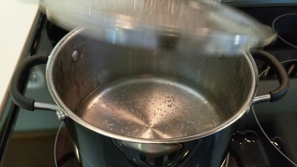 To check if the water has boiled, remove the lid - boil egg
