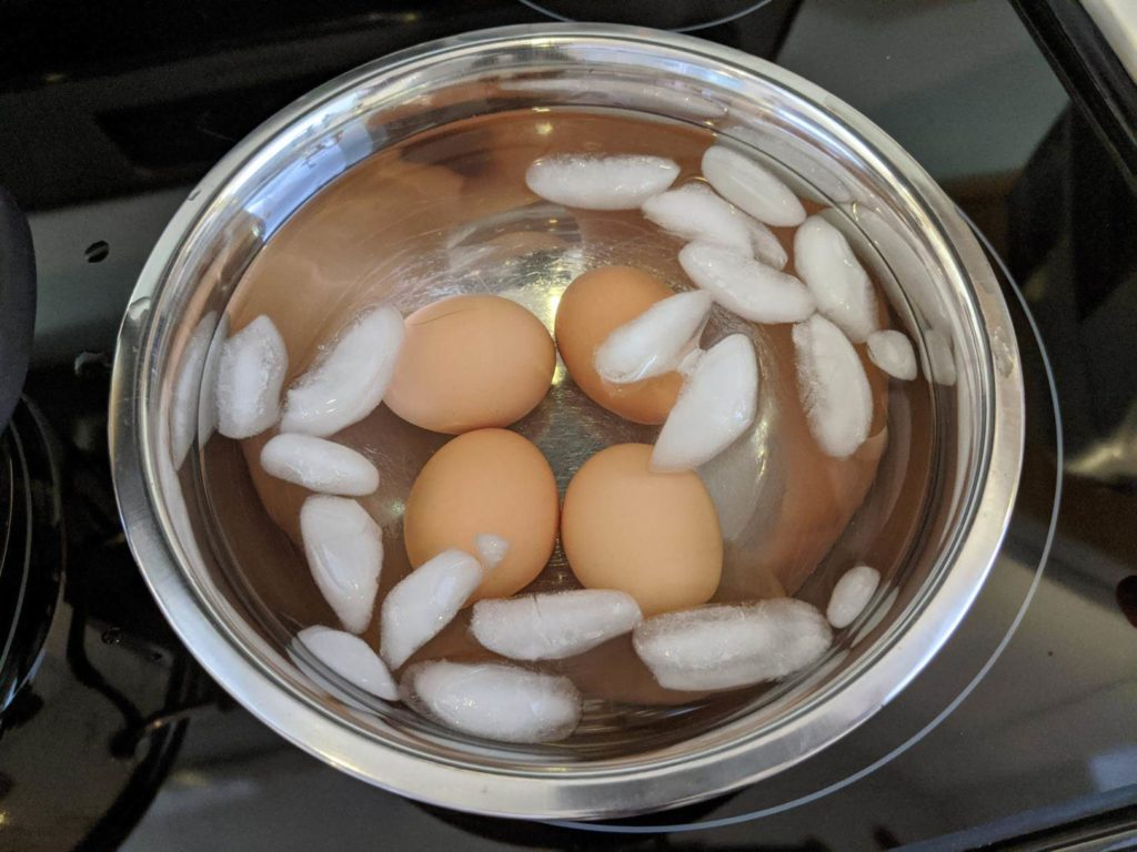 Boiled eggs in an ice bath to stop the eggs from continually cooking